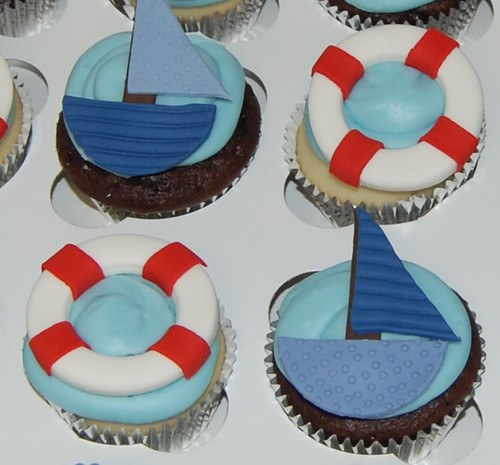 1st birthday nautical themed cupcakes - boats and life preservers