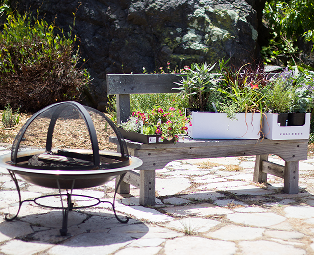 outdoor fire pit, new flowers for the garden sitting on a bench