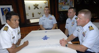 Capt. Gregory Case, commanding officer of Coast Guard Sector St. Petersburg, Fla., speaks with W. Villegas, the commanding officer of the ARC Gloria, a Colombian naval tall ship, in Tampa Wednesday, July 2, 2014. The Gloria is a training vessel for the Colombian navy similar to the Coast Guard Cutter Eagle, home-ported in New London, Conn. (U.S. Coast Guard photo by Petty Officer 1st Class Crystalynn Kneen)