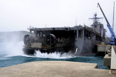 WHITE BEACH, Okinawa (June 27, 2011) A Landing Craft Air Cushion departs from the well deck of the forward-deployed dock landing ship USS Germantown (LSD 42).  The ship was in Okinawa embarking Sailors and Marines with the 31st Marine Expeditionary Unit. (U.S. Navy photo by Mass Communication Specialist 1st Class Johnie Hickmon)