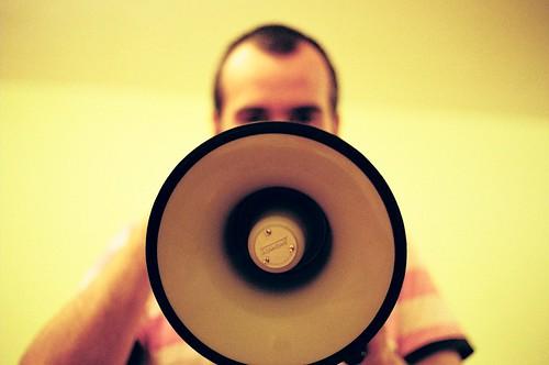 Man holding megaphone - photo (c) miuenski on Flickr