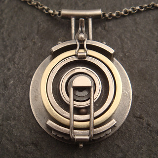 wedding ring holding pendant