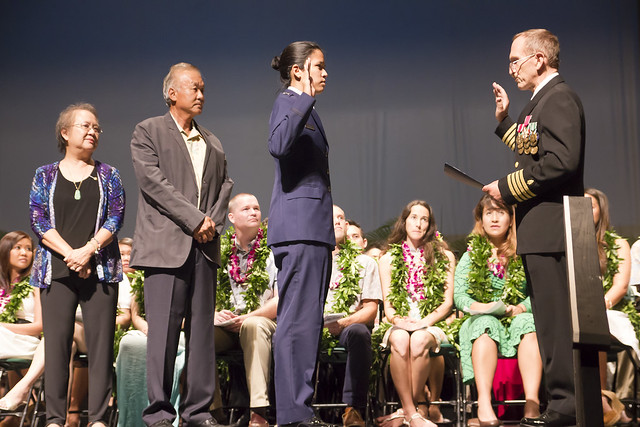 "<p>During the John A. Burns School of Medicine convocation on May 18, 2014, William Haning, a JABSOM professor and a Navy captain (ret.) who serves as the professional services liaison puffier for Hawaii, leads USAF Captain Michelle Lee in the commissioning oath, as her parents look on. This also represents her transition to active duty from a reserve status.<br /> <br /> For more photos go to <a href=""https://www.flickr.com/photos/uhmed/sets/72157644739148255/"">www.flickr.com/photos/uhmed/sets/72157644739148255/</a> and <a href=""https://www.flickr.com/photos/uhmed/sets/72157644324989199/"">www.flickr.com/photos/uhmed/sets/72157644324989199/</a></p>"