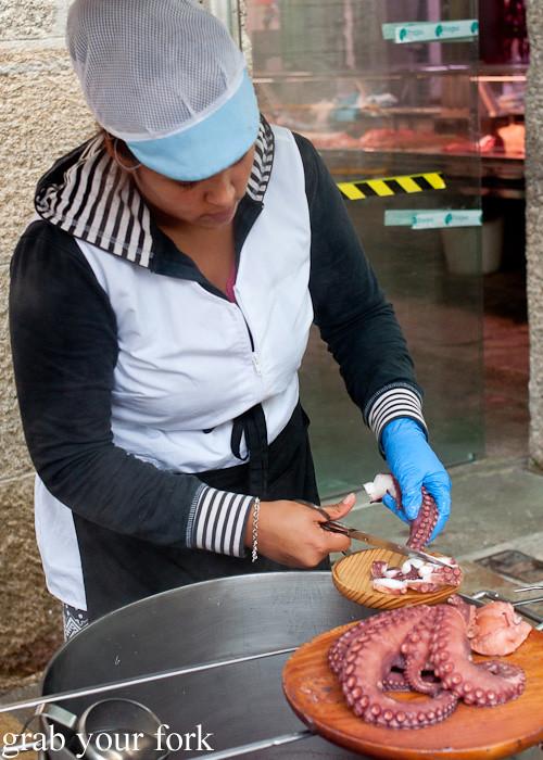 Pulpo a Gallega Galician octopus at Mercado de Abastos farmers market in Santiago de Compostela, Spain