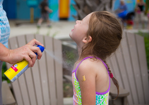 Spraying Banana Boat Kids Tear Free Sunscreen #BBBestSummer #Shop