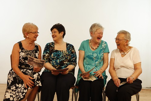 four older women laughing together