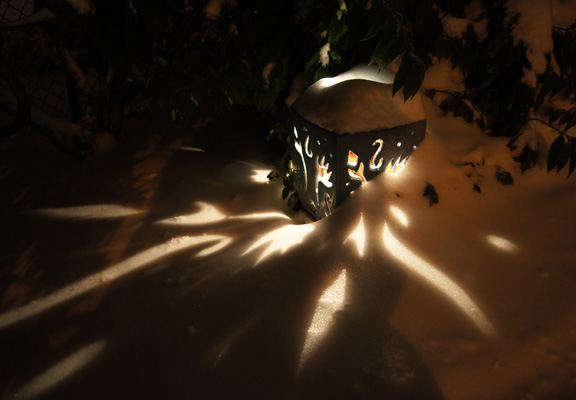 Snow brings out the magic in garden lanterns.