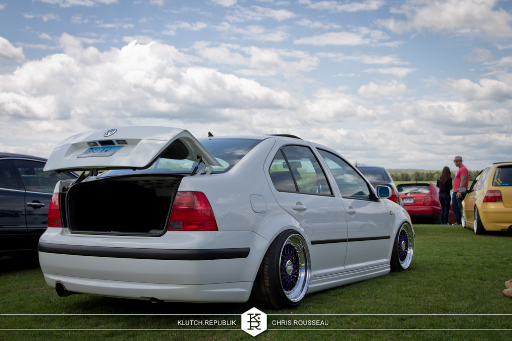 white mk4 vw jetta on airride and purple bbs rs wheels at staggered 2012