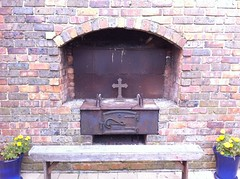 fireplace(0.0), hearth(0.0), masonry oven(1.0), iron(1.0), brick(1.0), brickwork(1.0),