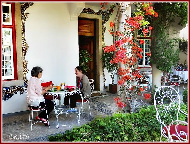 A pair of ladies having tea.
