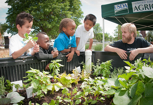 Farmers markets are a perfect venue for teaching children about the food they eat.  Initiatives across the country, like this People's Garden event at the USDA Farmers Market, encourage the development of healthy eating habits at an early age.
