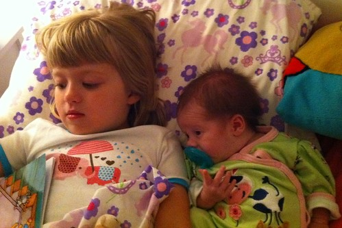 Sisters cozied up at bedtime