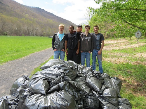 Students from the Elkins Mountain School in Elkins, West Virginia, participate in Garlic Mustard Challenge, filling bags of the invasive species. (U.S. Forest Service)