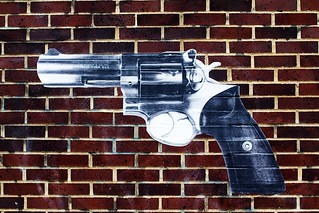 handgun on bricks