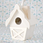 Detailed mini wooden bird house