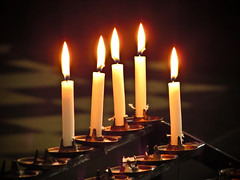 hanukkah(0.0), candle(1.0), light(1.0), darkness(1.0), flame(1.0), lighting(1.0),