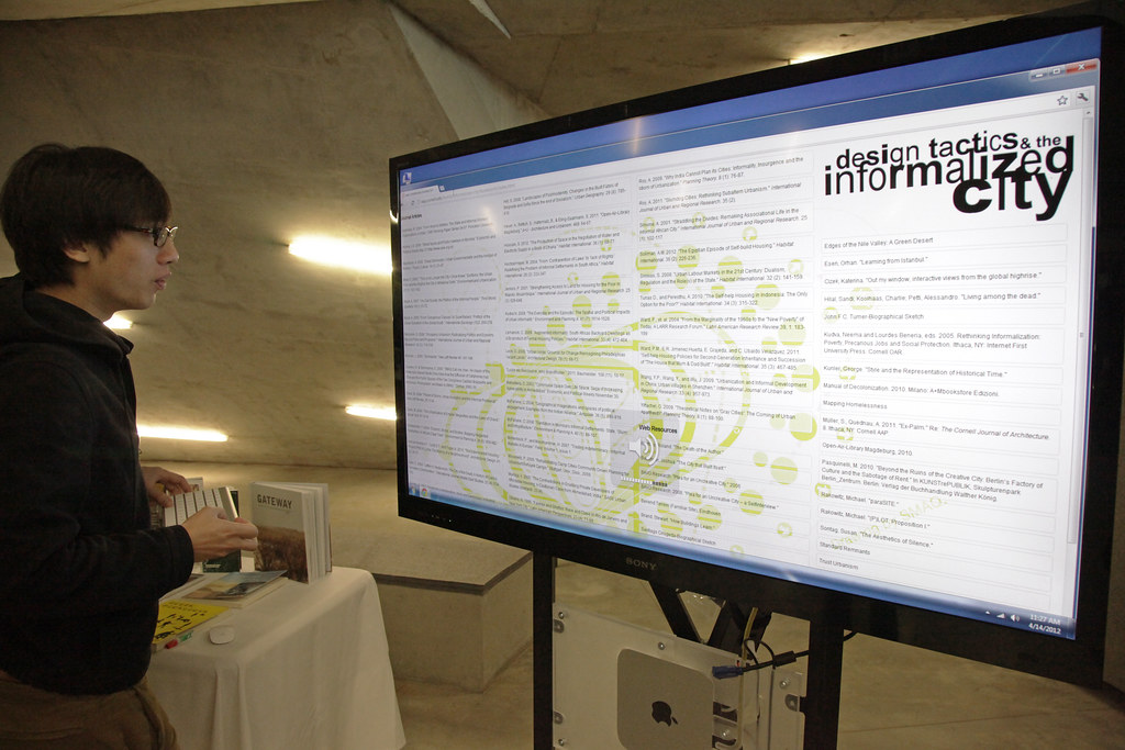 Guests accessed symposium and web information at LCD installation in Milstein Hall dome area.