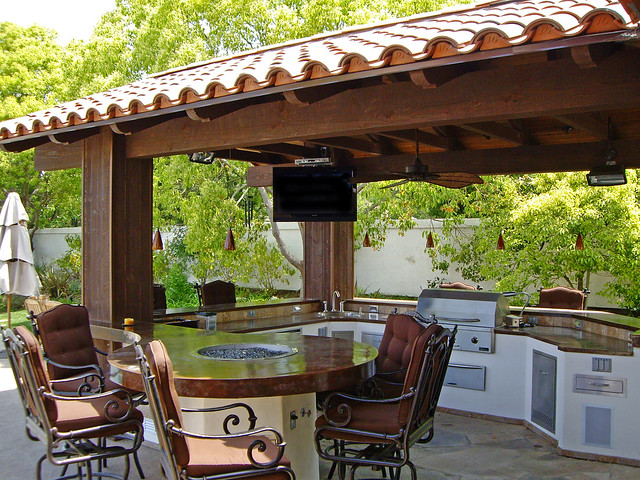 outdoor kitchen with round table and pergola flickr
