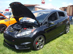 race car(0.0), sedan(0.0), automobile(1.0), automotive exterior(1.0), supermini(1.0), vehicle(1.0), automotive design(1.0), bumper(1.0), ford(1.0), ford fiesta(1.0), land vehicle(1.0), hatchback(1.0),