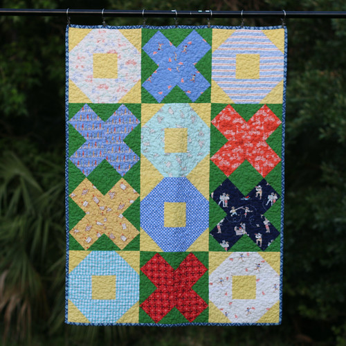 Xs and Os quilt - his first quilt