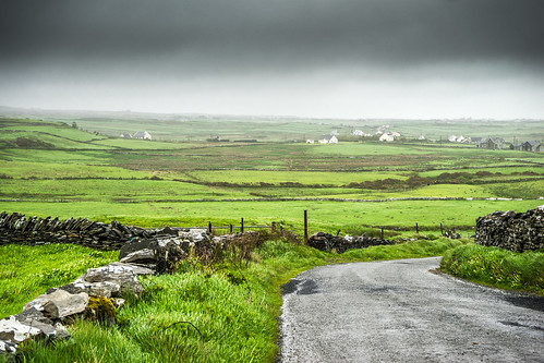 street travel ireland houses sky storm black grass clouds dark landscape photography photo rocks europe clare day sony country streetphotography onsale sonya7 sel2870