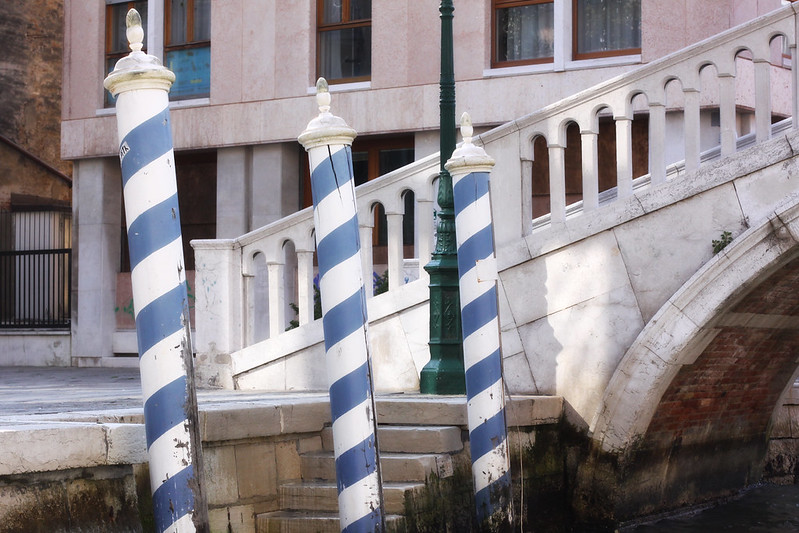 Blue and White Striped Poles