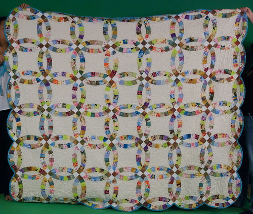 25 Nov 2010 - 20:48 - Okay, so we didn't totally hold it straight, but that's okay ... you get the idea. Much of the humor in this quilt can't be seen from this angle -- you don't see all the weird and funny pieces (pink and black skulls! backing fabric of cartoony bugs!) but this at least lets you see the overall effect. A traditional quilt done in as non-traditional a manner as possible!  Blog entry: domesticat.net/quilts/serendipity