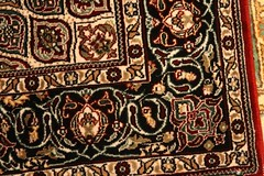 carving(0.0), flooring(0.0), tapestry(1.0), art(1.0), pattern(1.0), textile(1.0), brown(1.0), prayer rug(1.0), design(1.0), carpet(1.0),
