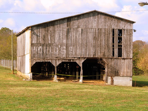 "Very faded ""See Rock City"" barn"