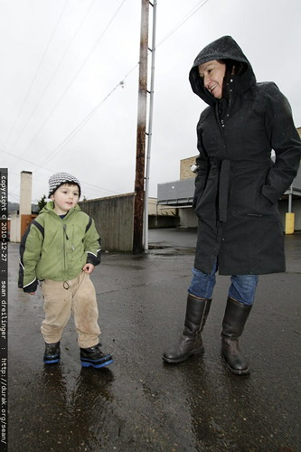 "i think he's telling grandma ""don't worry, my boots are waterproof"""
