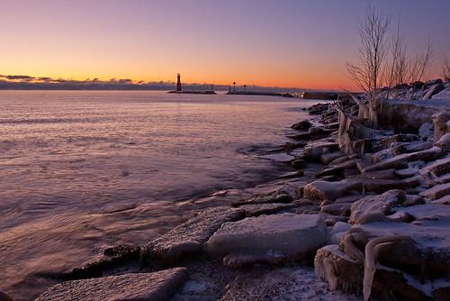 christmas lighthouse cold tree ice wisconsin sunrise harbor frozen rocks purple lakemichigan breakwater algoma
