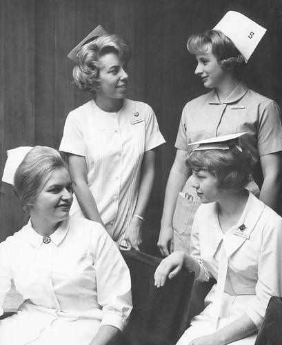 Gertrude Kristoffersen, Gail Yando, Esther Rosewall, Delores Witmer comparing nursing caps