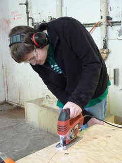 Connor cutting plywood