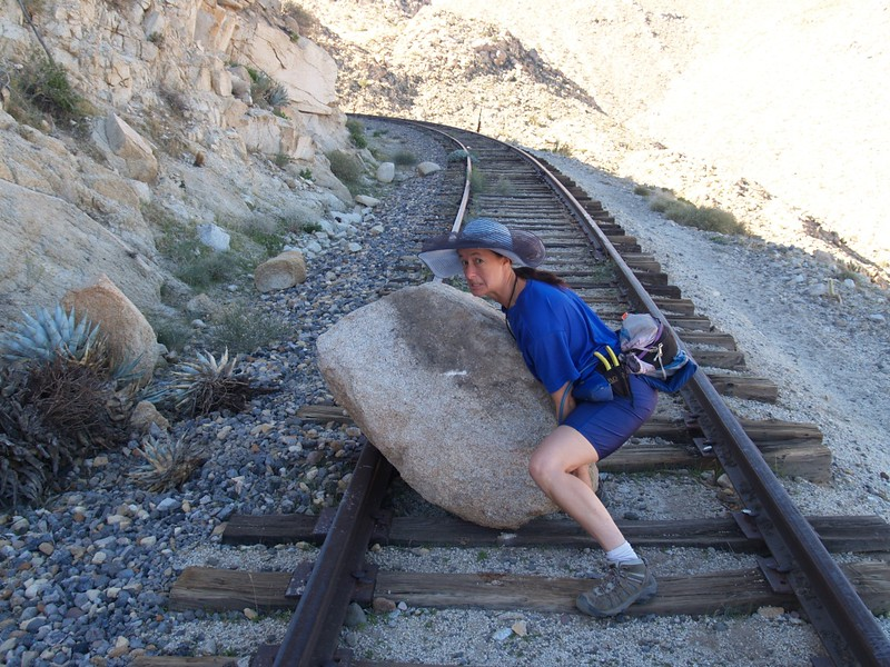 Vicki pretends to move the big boulder off the tracks