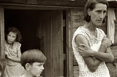 The family of a Resettlement Administration client in the doorway of their home, Boone County, Arkansas, by Ben Shahn 1935