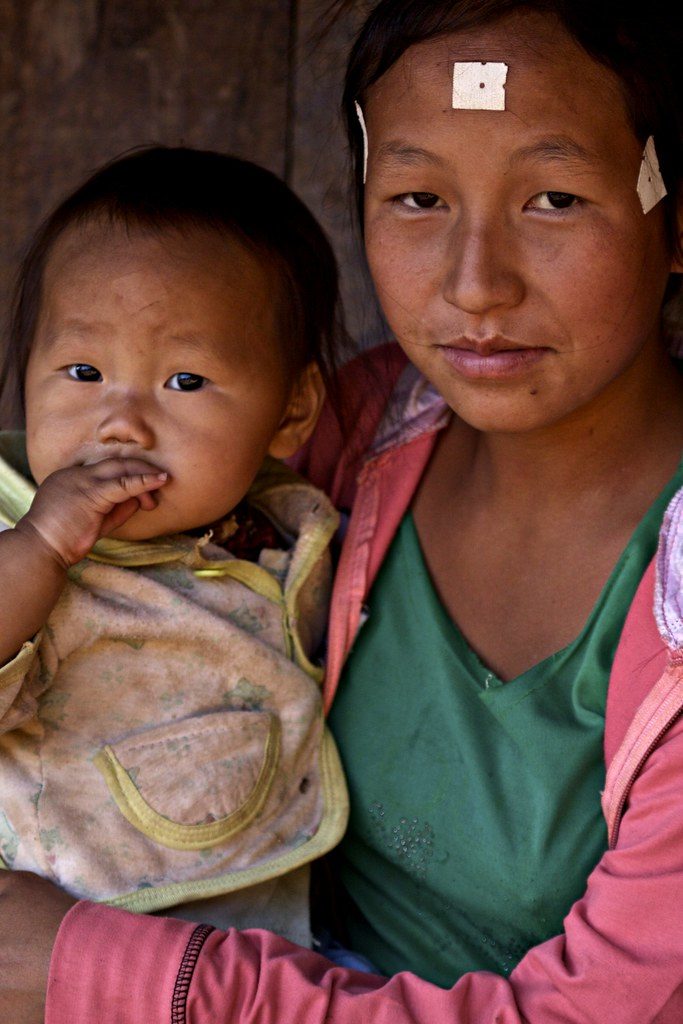 A Hmong Woman With Her Infant