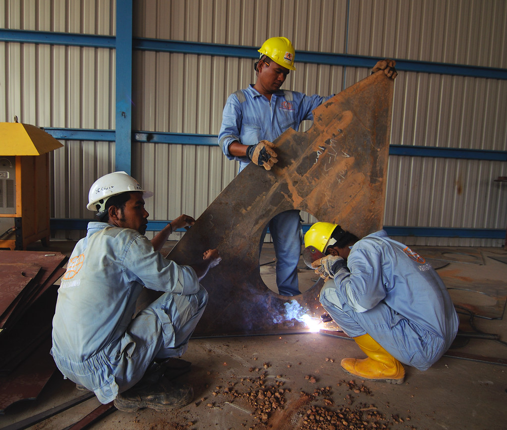 Workers at a shipyards in Kabil, Batam, Indonesia