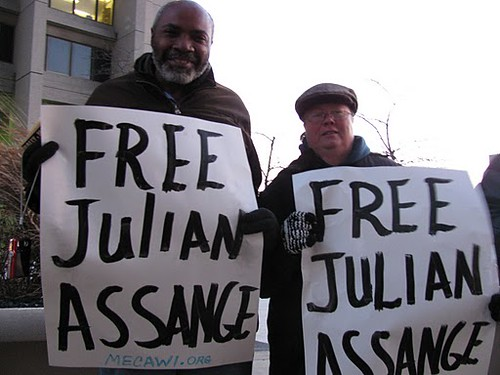 Abayomi Azikiwe, editor of the Pan-African News Wire, and UAW member and labor writer, Martha Grevatt, standing tall for WikiLeaks Founder Julian Assange being held in the UK without bail. (Photo: Bryan Pfeifer) by Pan-African News Wire File Photos