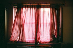 The heat rising from my radiator would be trapped behind the drapes, and I would be cold.