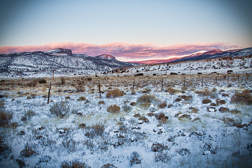sunset sky snow mountains newmexico field clouds fence landscape glow newyears2011