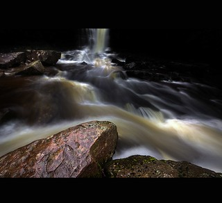 """ STOOD ON SLIPPERY ROCKS WITH YOUR BACK PACK , TRIPOD AND AN UMBRELLA IN ONE HAND TRYING TO GET THE SHOT """