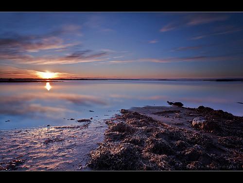 ocean railroad blue sunset sea orange sun water clouds canon landscape iceland sand kelp shore 5d 1740 ísland sjór eyrarbakki sólsetur sólarupprás bigstopper