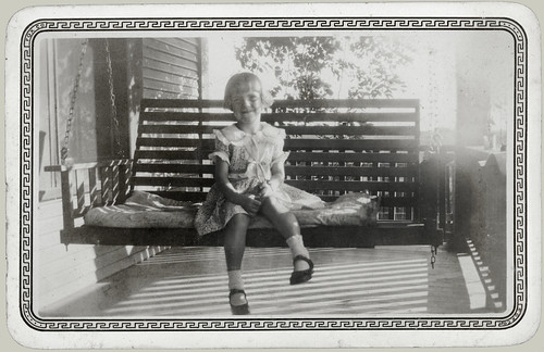 Girl in a porch swing
