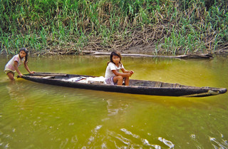 Girls in canoe  along Napo River, Peru