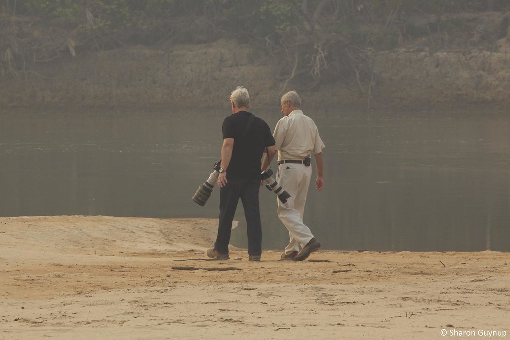 Steve Winter and Bob Simon walking along river in the Pantanal