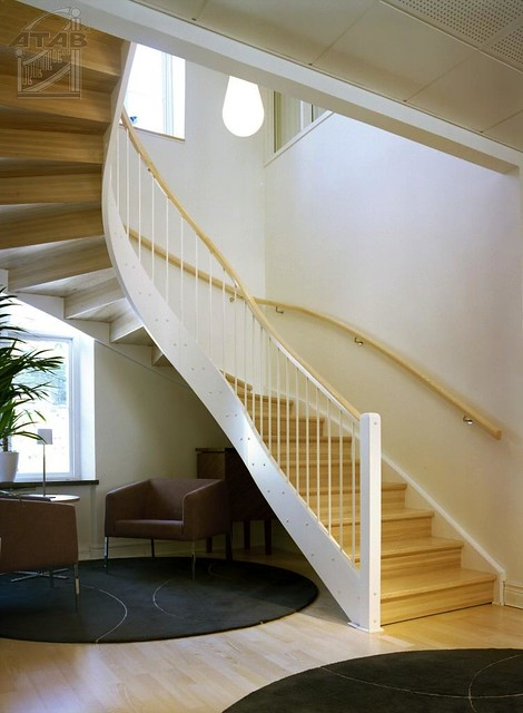 Half turn staircase with closed risers and wall handrail ...