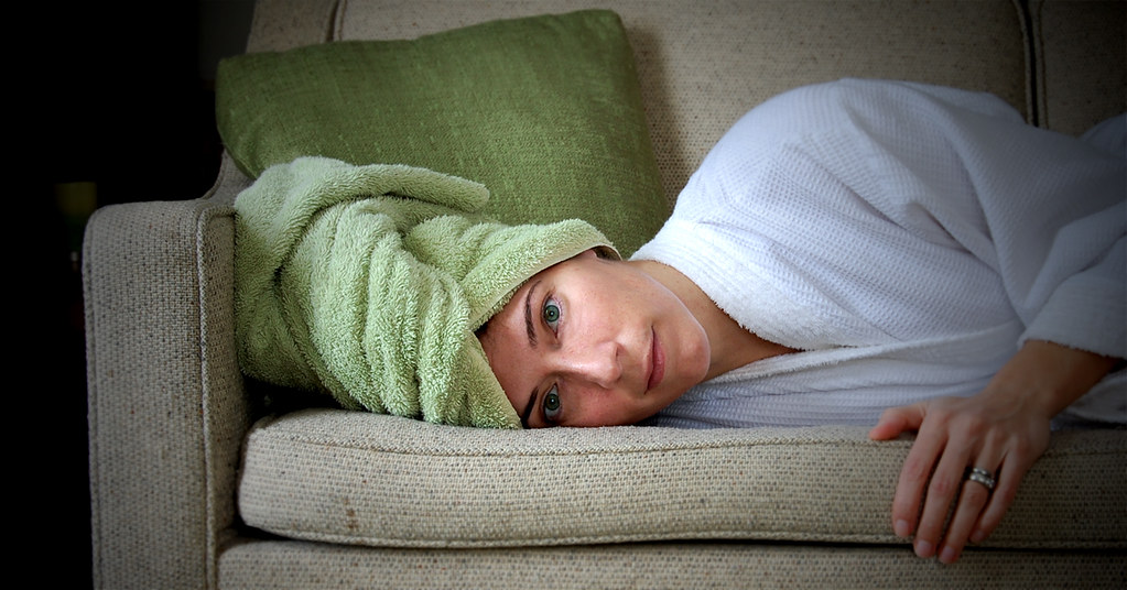wrapped in a towel, resting with a sinus infection