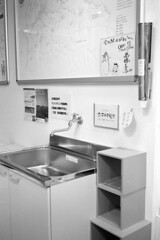 shelf(0.0), kitchen(0.0), countertop(0.0), bathroom cabinet(0.0), design(0.0), cabinetry(0.0), bathroom(0.0), furniture(1.0), white(1.0), room(1.0), interior design(1.0), sink(1.0),