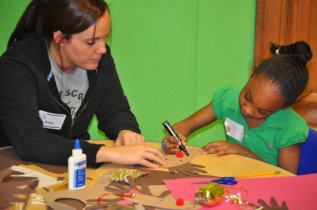 Anna Monroe of the Michigan Municipal League Helps Detroit Families at the Holidays