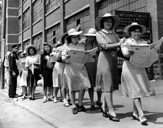 Women standing in a picket line reading the newspaper PM. | by Kheel Center, Cornell University Library